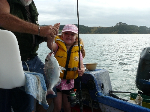 A very happy Kaitlyn (5y) reels in her first fish