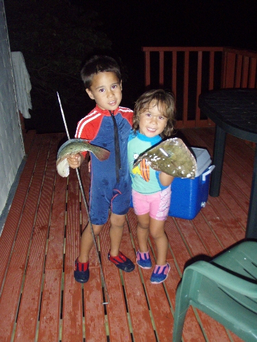 my kids spearing there first flounders