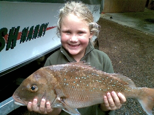 7 year old Jasmyn  stoked with her first Snapper