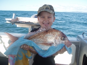 Charlie Hawke (4 Yrs) stoked with his snapper!