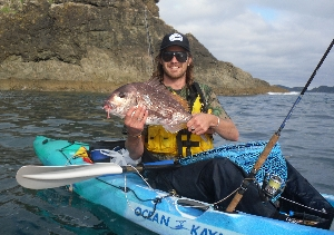 Dan farrel with a snapper pulled from a deep gut. Stealth yak plastics