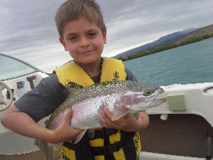 Sam Charles with his 1st 5pound rainbow trout.