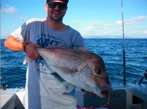 50m water on soft bait grub.